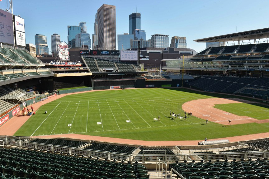 Grounds crew paint football lines and numbers on the grass at Target Field in Minneapolis in preparation for this Saturday's St. Thomas vs. Saint John's football game, Wednesday, Sept. 20, 2017. (Scott Takushi / Pioneer Press)
